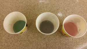 Left: Red Cabbage Water mixed with Baking Soda (a base); Center: Red Cabbage Water alone; Right: Red Cabbage Water mixed with vinegar (an acid)
